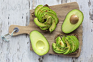 Protein bread garnished with sliced avocado, cress and chili powder - SARF002634