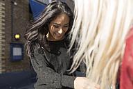 Smiling young woman scrutinizing female friend - BOYF000192