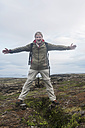 Iceland, man at Thingvellir rift zone - PAF001675