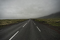 Iceland, empty road in fog - PAF001715