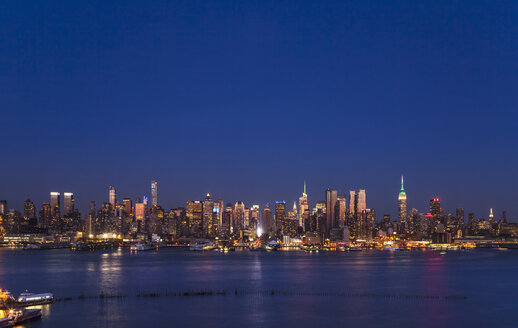 USA, New York City, view to Midtown Manhattan at night - HSIF000429