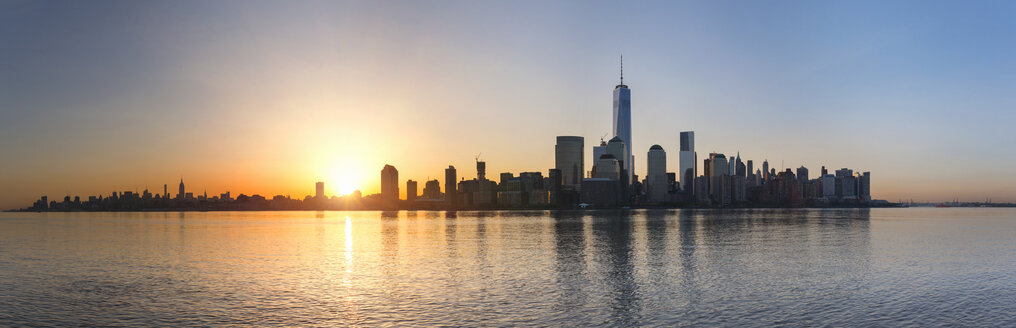 USA, New York City, Manhattan, panorama of financial district at sunrise - HSIF000438