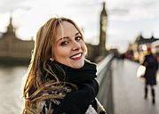UK, London, portrait of smiling young woman on Westminster Bridge - MGOF001550