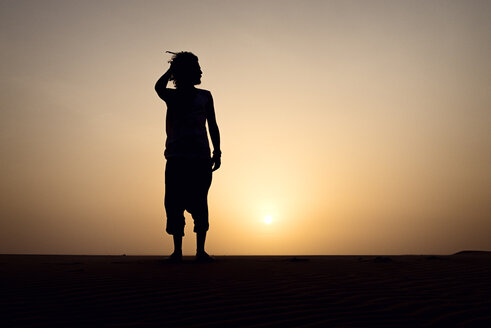Silhouette of man standing on dune - BMAF000125