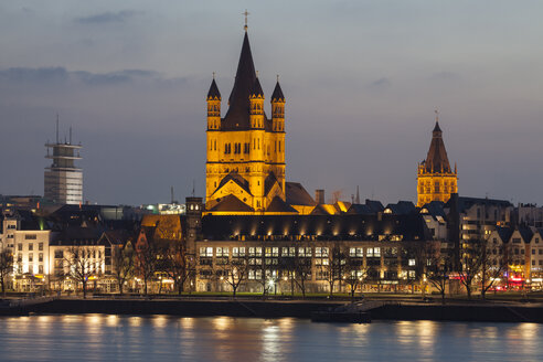 Germany, Cologne, view to the old town with Gross Sankt Martin and town hall at evening twilight - WIF003292