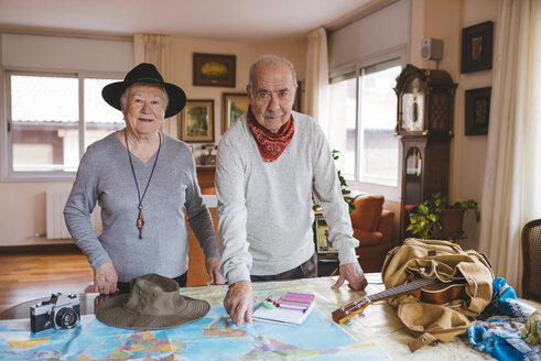 Elderly couple planning a trip on a map - GEM000796