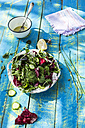 Spring salad of baby spinach, herbs, arugula and lettuce, dressing of yogurt, olive oil, honey and lemon - DEGF000710