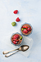 Glasses of Mousse au Chocolat garnished with raspberries, strawberries and hardy kiwi - MYF001410