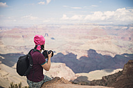 USA, Arizona, Young tourist taking pictures in Grand Canyon - EPF000033