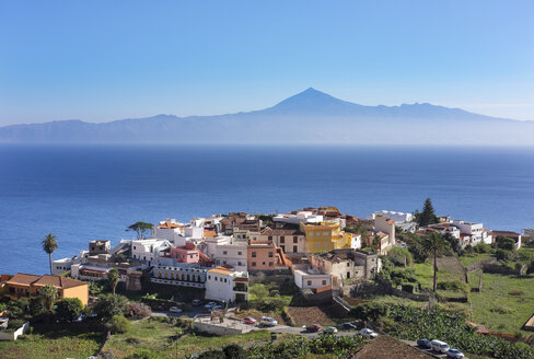 Spain, Canary Islands, La Gomera, Agulo, Teneriffa Island with Pico del Teide in the background - SIEF006990