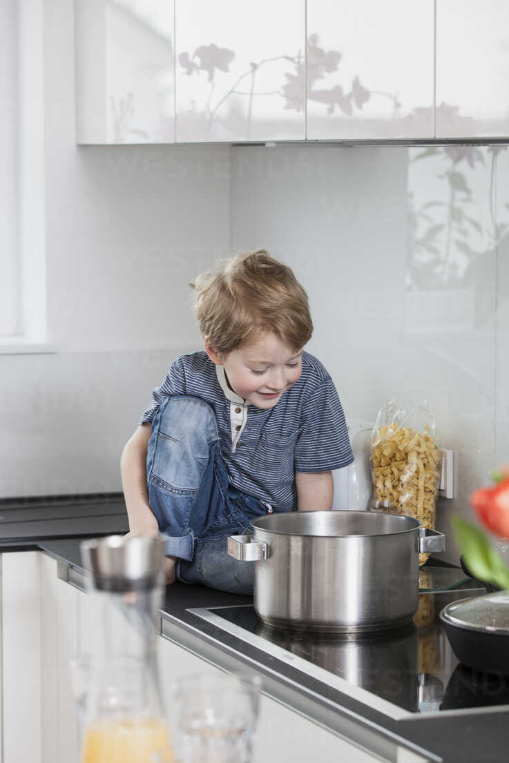Little Boy Helping To Prepare Food In The Kitchen Stockphoto