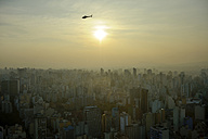 Brazil, Sao Paulo, cityview and helicopter in the evening - FLKF000649