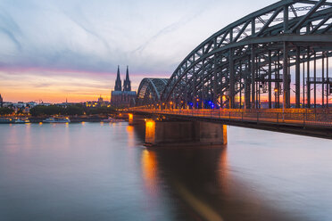Germany, Cologne, view to Cologne Cathedral with Hohenzollern Bridge in the foreground - TAMF000414