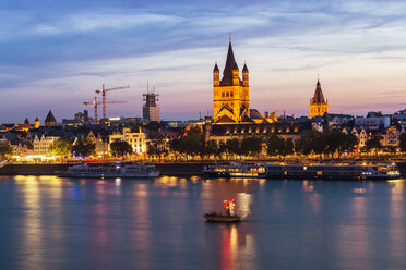 Germany, Cologne, view to the lighted city with Gross Sankt Martin and city hall - TAMF000417