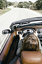 Woman driving a convertible car - ABZF000295