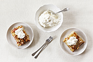 Pieces of whole meal apple pie with sliced almonds and whipped cream - EVGF002860
