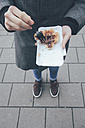 Belgium, Antwerp, young man eating Belgian waffles on the street - RTBF000025