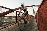 Racing biker on a bridge - JASF000563
