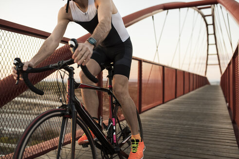 Racing biker on a bridge, partial view - JASF000566