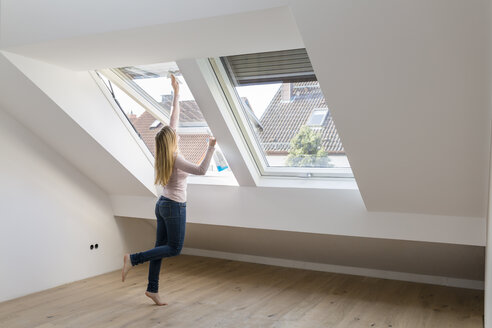 Woman cleaning window in her new penthouse - SHKF000521