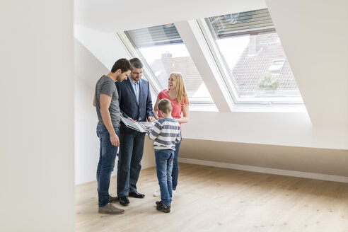 Estate agent showing family sample card in their new penthouse - SHKF000530