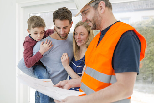 Construction worker explaining family the construction plan - SHKF000554