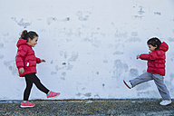 Two little girls playing in front of a wall - ERLF000152