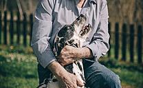 Senior man hugging his Dalmatian dog - DAPF000049