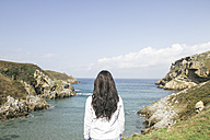 Back view of woman looking to the sea - ABZF000296