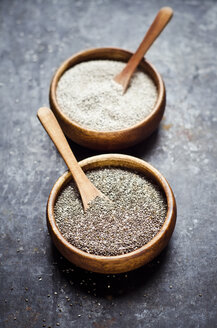 Wooden bowls of black and white chia seeds - CZF000244