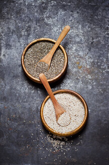Wooden bowls of black and white chia seeds - CZF000247