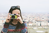Hungary, Budapest, woman taking a picture from Gellert Hill - GEMF000814