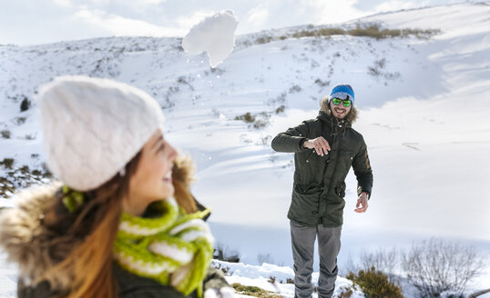 Spain, Asturias, couple playing in the snow - MGOF001656