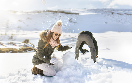Spain, Asturias, couple playing in the snow - MGOF001665