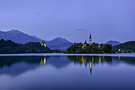Slovenia, Gorenjska, Bled, Bled Island, Assumption of Mary's Pilgrimage Church and Lake Bled in the evening - RUEF001675