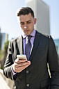 USA, Los Angeles, businessman looking at cell phone - LEF000007