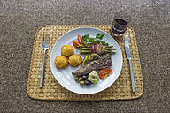 Lamb fillet with croquettes, green beans bacon-wrapped, artichoke, tomato and chili pepper, red wine glass - PVCF000815