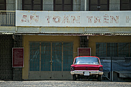 Vietnam, Da Lat, old car in front of an house - KNTF000253