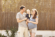 Portrait of happy family of three - MFRF000505