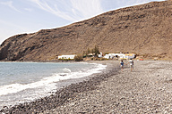 Spain, Fuerteventura, couple with baby walking on beach - MFRF000523
