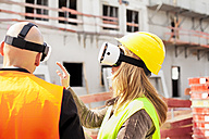 Two persons with Virtual Reality Glasses at construction site - MAEF011438