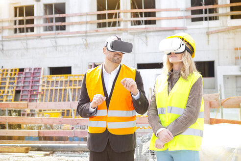 Two persons with Virtual Reality Glasses at construction site - MAEF011441