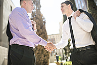 Two businessmen shaking hands outdoors - LEF000026