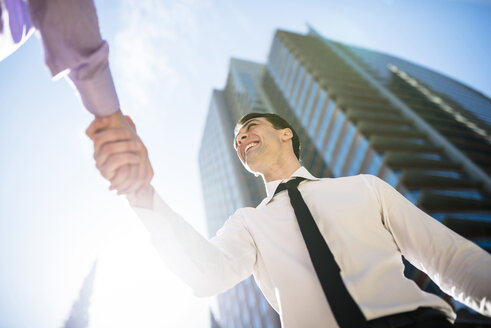 Two businessmen shaking hands outdoors - LEF000029