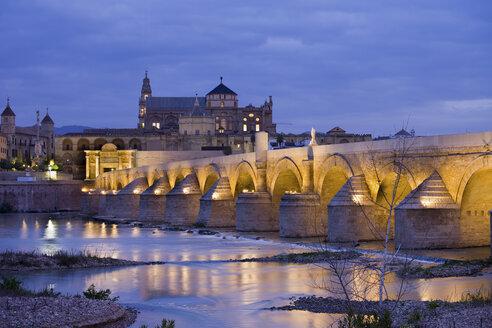 Spain, Andalusia, Cordoba, Mezquita Mosque Cathedral at dawn, Roman Bridge on Guadalquivir river - ABOF000085