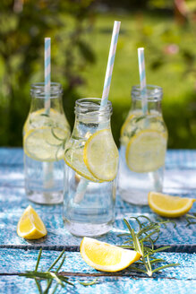 Slice of lemon and rosmary in water bottles, drinking straws - SARF002668