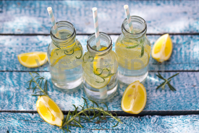 Slice of lemon and rosmary in water bottles, drinking straws - SARF002671