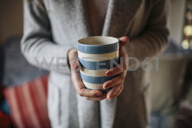 Young woman at home drinkin cup of coffee - HAPF000305