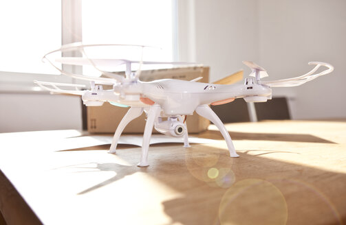 Drone on a table at backlight - MFRF000535