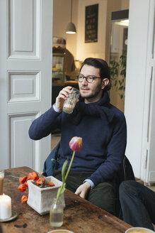 Man in a cafe with Latte Macchiato - JUBF000120